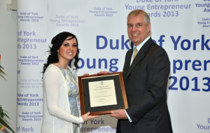 Ashleigh Rodda receives her Young Entrepreneur Award from Prince Andrew